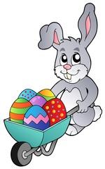 Bunny holding wheelbarrow with eggs