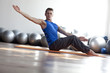 man practicing pilates in light gym
