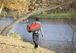 Man  with large sport bag going for outdoor training in park