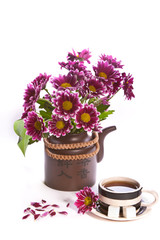 cup of tea and flowers in a teapot