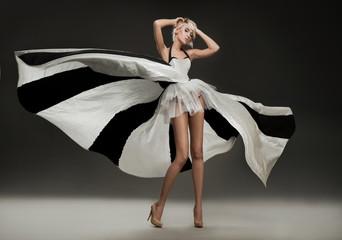 Beautiful blonde in marvelous dress