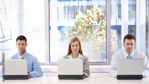 Young businesspeople with laptops