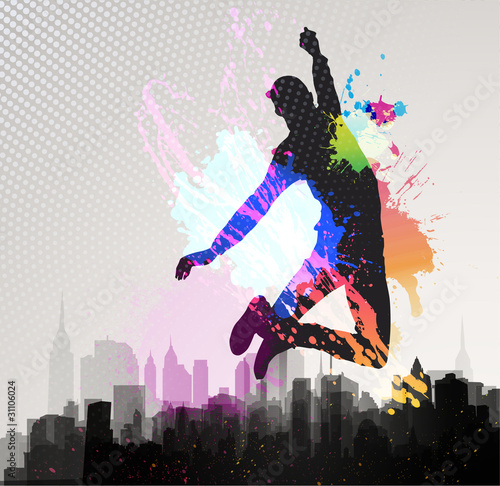 Young man jumping over city background.