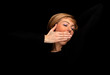yawning stretching young blond hair woman, black background.