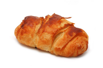 Single fresh croissant, casting soft shadow isolated on white