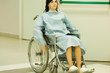 Female patient using wheelchair, blurred motion