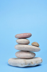 zen stones on a blue background