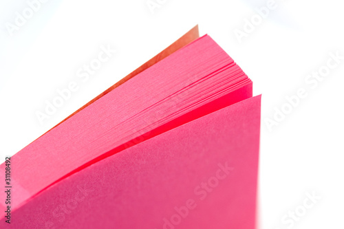 pink office memo pad on white