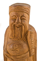 Wooden statue of a chinese wise man closeup