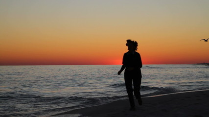 Woman Jogging At Twilight