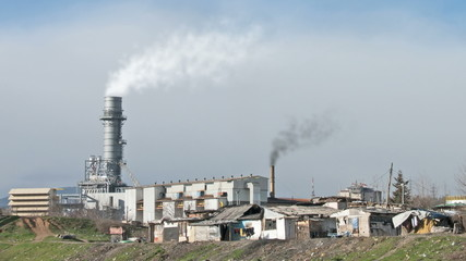 smoking factory chimneys surrounded by poverty. looped, HD