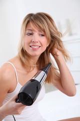 Beautiful woman drying her hair