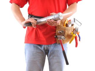 Construction worker with caulking gun over white background.
