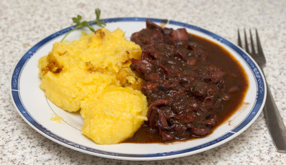 Polenta with octopus stew, Croatian speciality