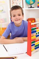 Happy kid solving math exercise