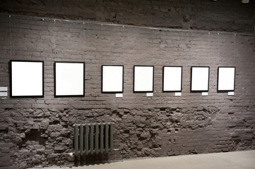 Empty frames on the brick wall