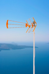 TV antenna against volcano in Santorini