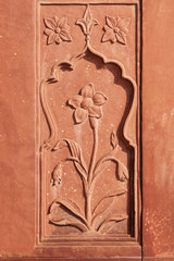 Flower stone carving in red sandstone at Red Fort.