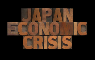 the words Japan economic crisis in old wood type