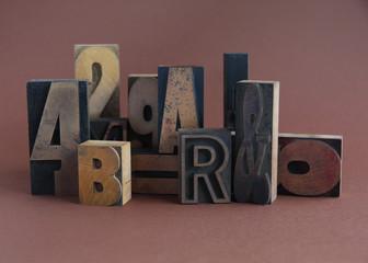 arrangement of letterpress wood type on a brown background