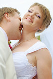 bride and groom fooling with funny expressions poster