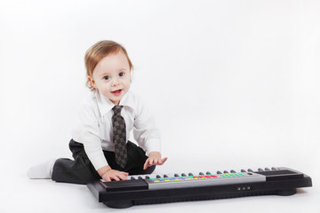 Portrait of the little musician on a white background