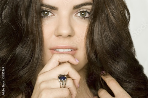 Beautiful woman wearing a luxurious ring. 25 carat saphire platinum ring with 7 carat diamonds