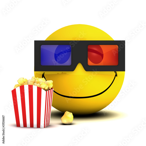 Happy smiley watches a 3d movie while eating popcorn