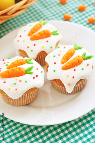 Easter cupcakes, with frosting and decorative carrots