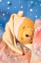 Kleiner schlafender Teddy