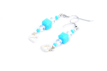 swarovski colored earrings on white background  isolated
