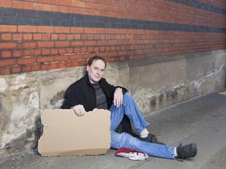 Man begging in street