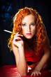 Sexy girl with red hair with amber mouthpiece on black