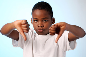 Boy making thumbs down gesture with both hands