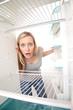 Teenager and empty fridge