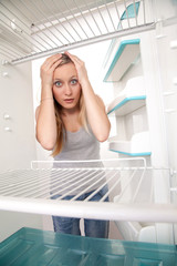 Girl and empty refrigerator