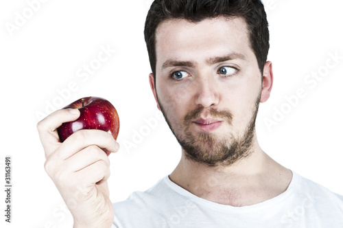Young man straing at an apple