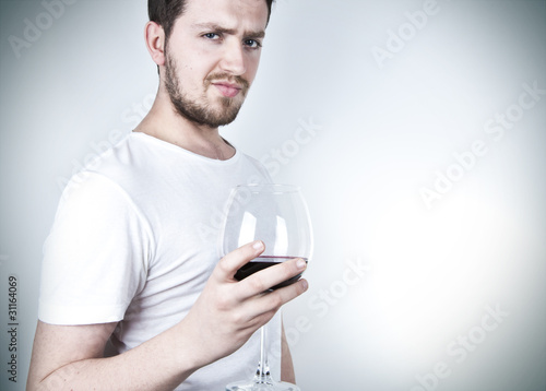 Young Man Posing with Wine