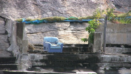 Blue Chair On A Rock