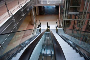 glass elevator shafts, escalators  in a modern office building