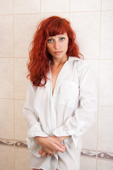 sexy young red-haired woman in shower