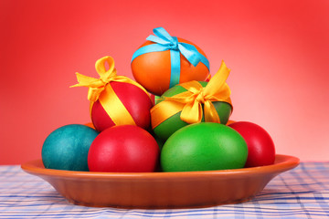 Easter eggs with  bows isolated on white