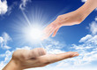 hand is catching the sun rays in their hands with clouds in the