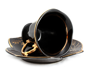 Black cup and saucer