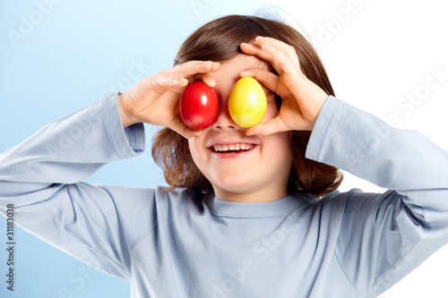 Little boy has fun with easter eggs