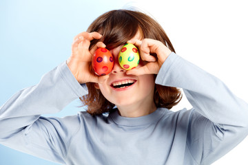Little boy has fun with two easter eggs