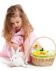 Girl playing with Easter bunny