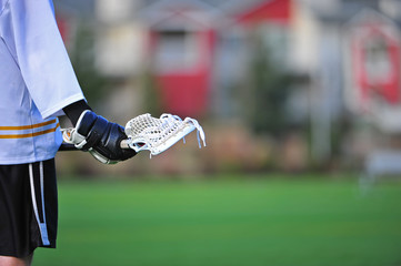 Boys lacrosse player holding stick