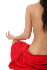 Young beautiful nude woman meditating