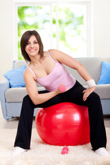 woman doing exercise on fit ball